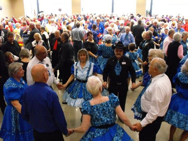 People country dancing wearing blue
