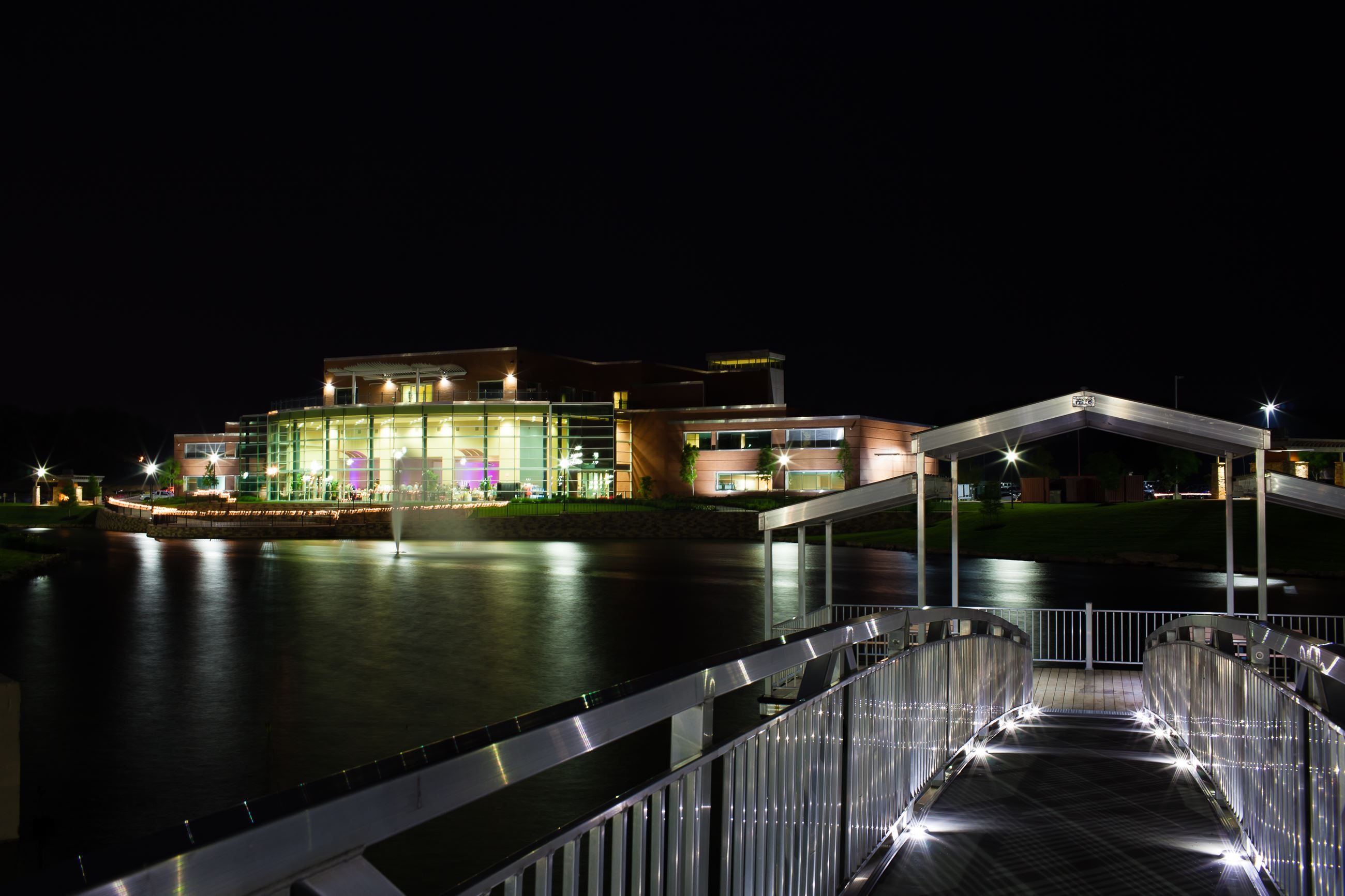 outside of conference center, pond, and dock at night
